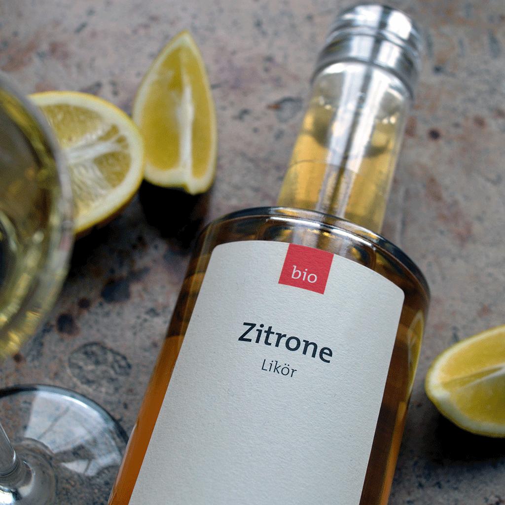 Bio Zitronenlikör (700 ml) mit Bio Zitronen und Glas - Destillerie Farthofer